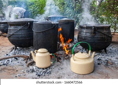 Big pots cooking outdoors in the village, African kitchen in the backyard
