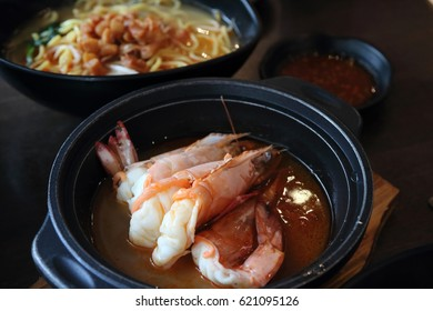 Big prawn noodle, a specialty dish unique to Singapore and Malaysia, consists of big prawn soup and noodle in a separate bowl