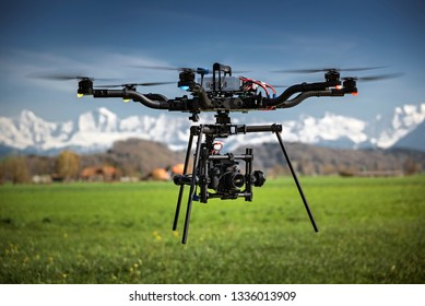 Big professional camera drone in mid-air on a film set