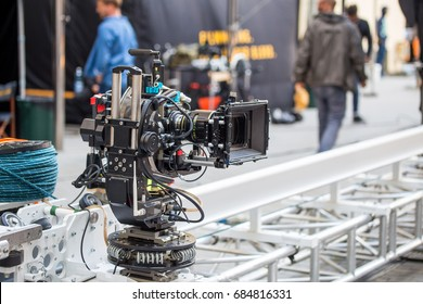 Big professional video camera moving on a rails on a movie set.