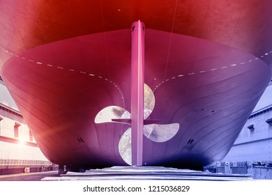 Big Propeller and rudder of Cargo ship Moored under Repair in floating dry dock in shipyard Thailand