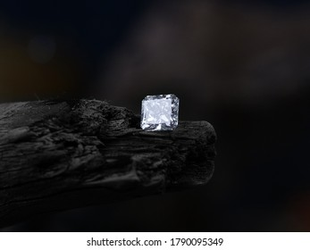 Big radiant cut diamonds on the old wood with blur background