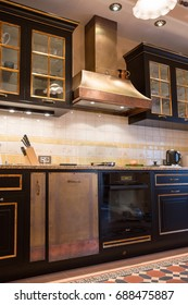 Big range hood and stove in the kitchen interior