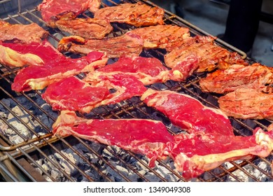 Big raw beef steak slice piece on barbeque grill table