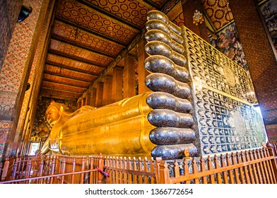 The Big Reclining Buddha statue in Wat Pho Temple, an Asian style Buddha Art, open to worship. Wat Pho is an important temple in Bangkok, Thailand.