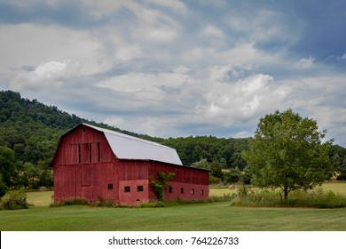 Big red barn in countryside.