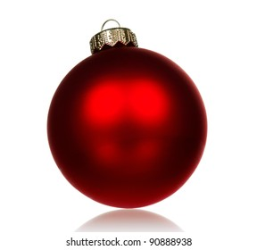 Big red bauble for christmas firtree on white background