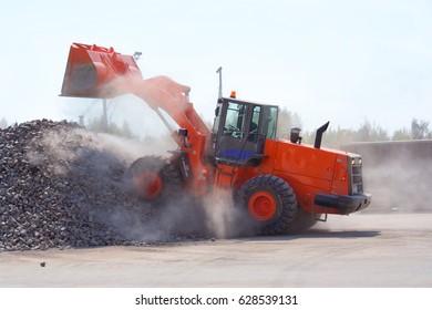 Big red bulldozer at work.
