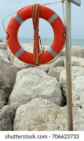 Big red buoy on the rocks to help swimmers in trouble