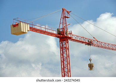 Big Red Construction Crane working in a site