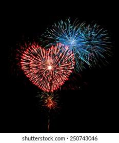 Big red heart shaped firework. Celebration fireworks display