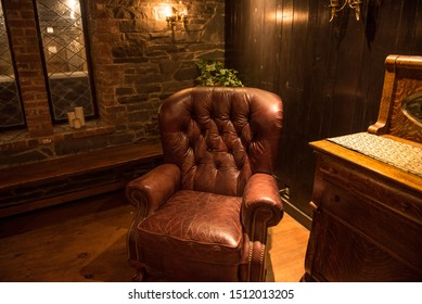 Big red leather chair in man cave