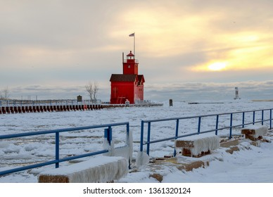 Big Red lighthouse in Holland Michigan in winter at sunset