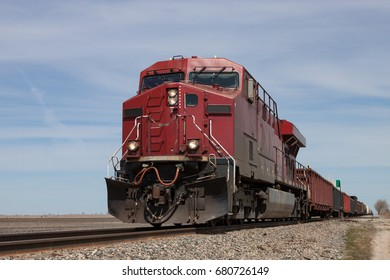 Big Red Locomotive Leading Freight Train on Canadian Prairie