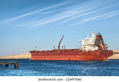 Big red oil tanker passes through the Suez Canal. Egypt