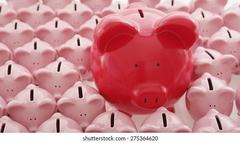 Big red piggy bank among lots of smaller ones