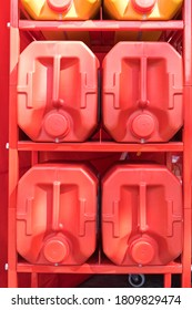 Big Red Plastic Canisters at Storage Rack