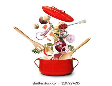 Big red pot for soup with fork and spoon