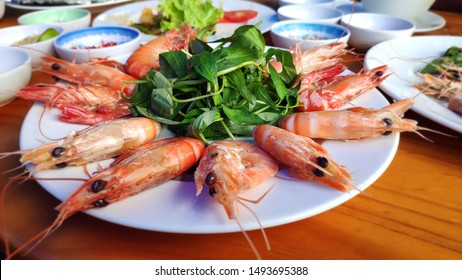 Big red shrimps Delicious king prawn boiled with head and  sweet chillies sauce green vegetable herbs on white plate Asian cuisine Thai traditional food healthy fresh seafood