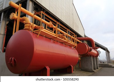 A big red tank is part of the Gas Works Factory to store and process gas, located in the Gas Works Park in Seattle, Washington, USA
