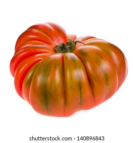 big red tomato RAF close-up isolated on white background