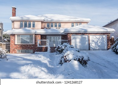 Big residential house in snow on winter season in Canada