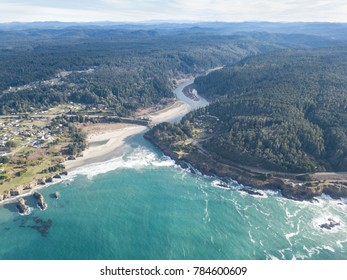 The Big River runs into the colorful waters of the Pacific Ocean along the rocky coastline of Mendocino in northern California. This scenic region is a few hours drive north of San Francisco.