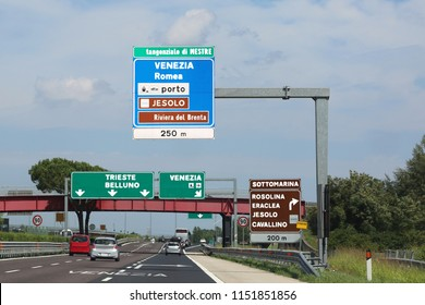 Big road sign on the highway with directions to go to many Italian cities like as Jesolo Venice or Trieste and more place