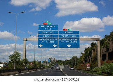 big road signs of the busy French highway that reaches Paris and other cities in France