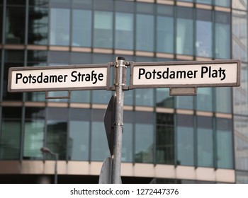 big road signs with street name of Potsdamer Strasse and Platz that means PotsDam street and square in Berlin in Germany