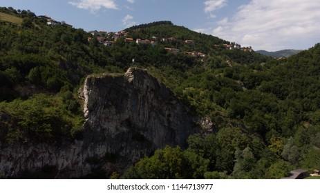 big rock and green hills
