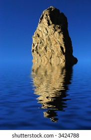 big rock with reflection and the sky