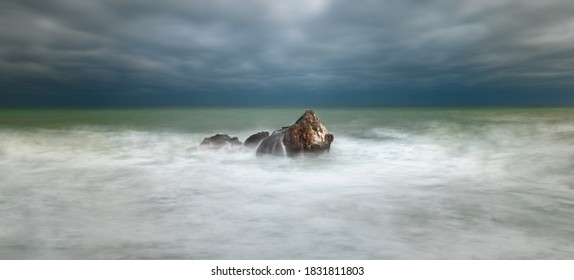Big rock in the sea during storm