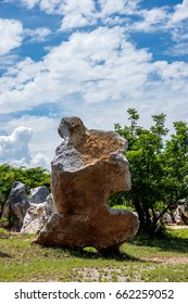 big rock under the beautiful blue sky and white cloud/big beauty rock