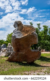 big rock under the beautiful blue sky and white cloud background/big beauty rock