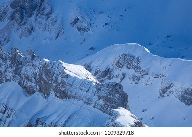 big rockface covered in snow