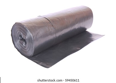 A big roll of disposable black plastic trash bags. Image isolated on white studio background.