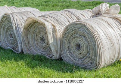 big rolls with foils for growing vegetables