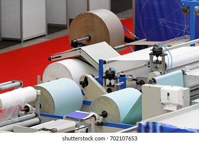 Big rolls of paper prepared for printing