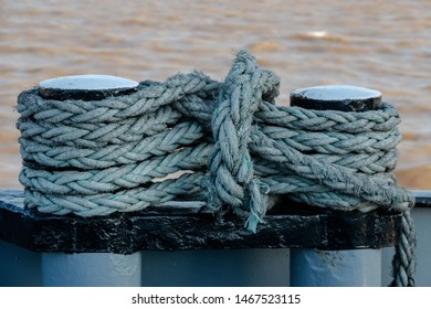 Big ropes wrapped around a bollard