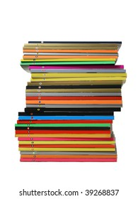 The big rough pile of shabby glossy magazines with multi-coloured bindings on a white background