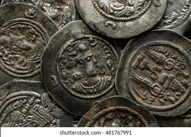 Big round silver ancient Sassanian coins, macro shot, overhead view