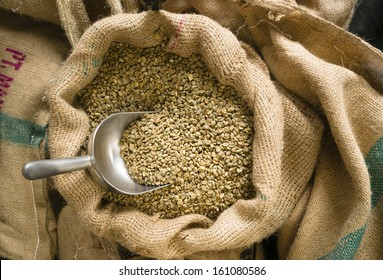Big sack of coffee beans waiting to be roasted in roaster warehouse food drink production