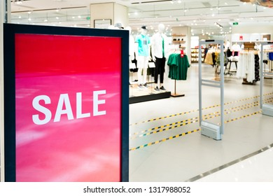 Big sale on billboard advertising in a large store.