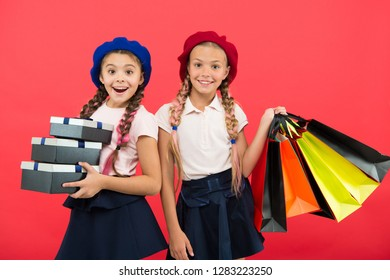 big sale in shopping mall. small girl children with shopping bags. Birthday and christmas presents. Happy shopping online. International childrens day. friendship and sisterhood. Online shop.