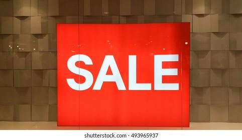 Big sale sign in beautiful window display.