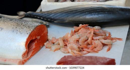 big salmon and fresh prawns in the fishmonger's counter