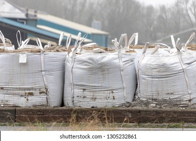 Big sand bags were placed beside the road, Bag with sand on construction site, Jumbo bags of sand are used for sandpits and under paving.