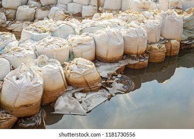 Lot of big sandbags for flood defense.