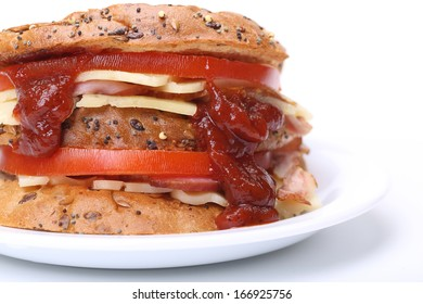 Big sandwich with bacon, cheese and tomato